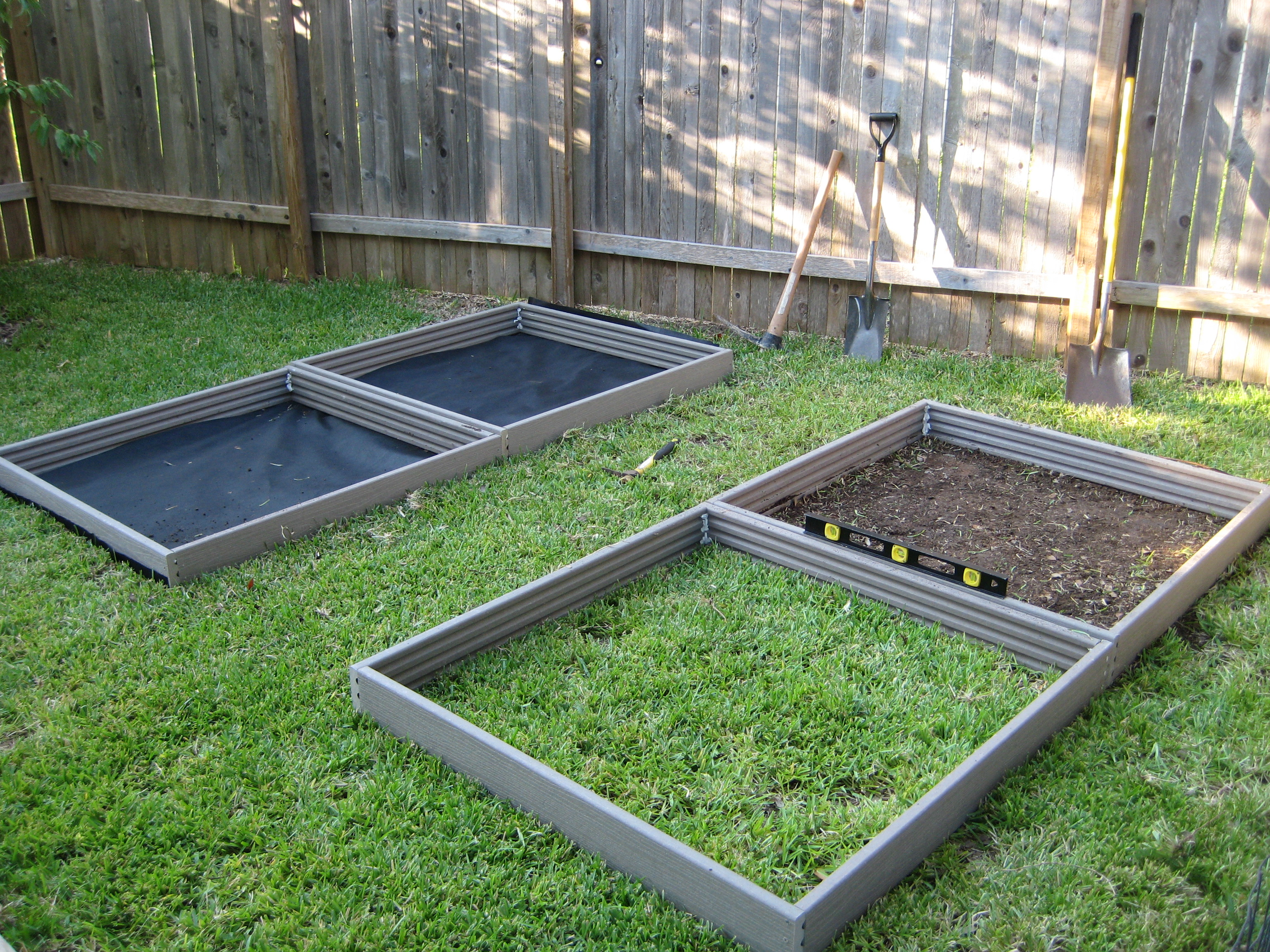 Raised beds in various phases of being installed once each bed is